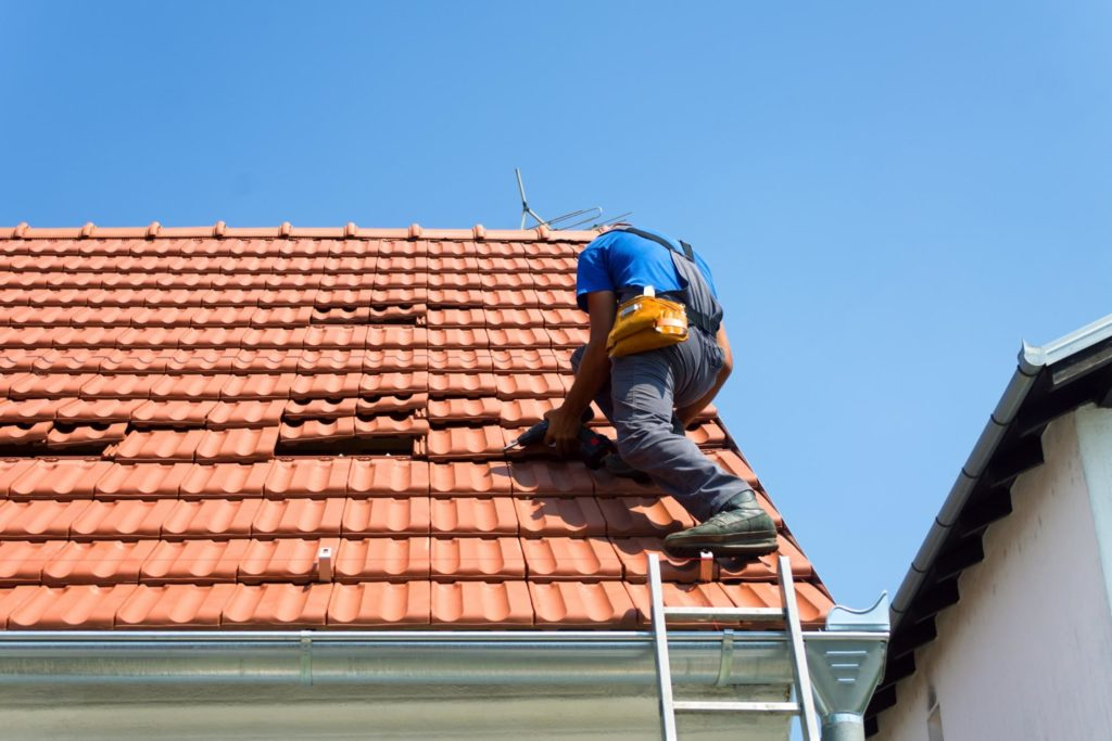 adjuster on roof of house